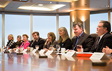 People sitting at large boardroom table