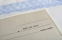 Detail photo of a cheque for five hundred eighty-four dollars and 36 cents