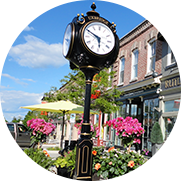 A main street with clock on pole